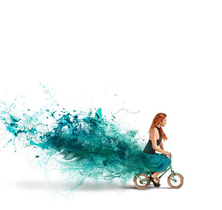 Photo for Concept of creative fashion with girl on bike - Royalty Free Image