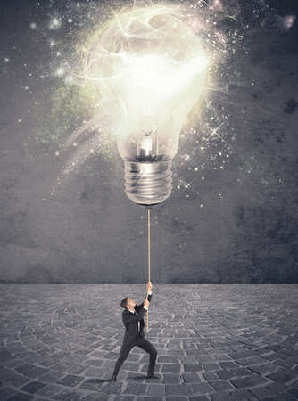 Photo pour Concept of illuminate an idea with a businessman and big lightbulb - image libre de droit