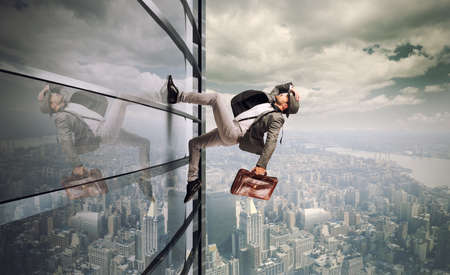 Foto de Determined man running up a skyscraper - Imagen libre de derechos