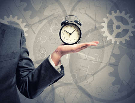 Photo for Concept of time with businessman that hold an alarm clock - Royalty Free Image