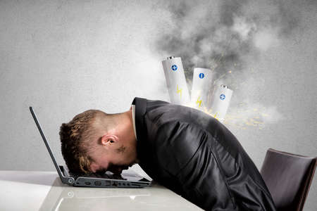 Photo pour Stressed businessman with explosion of discharged battery - image libre de droit