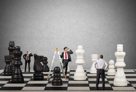 Photo pour Strategy and tactics of a team of businessman - image libre de droit