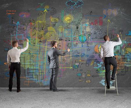 Foto de Business team drawing a new complex project - Imagen libre de derechos