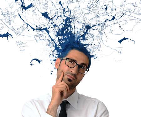 Foto de Creative businessman with blue color exit from the head - Imagen libre de derechos
