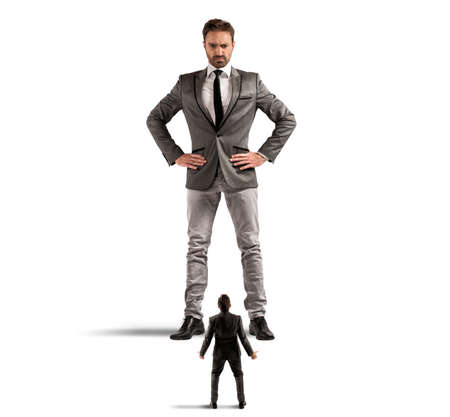 Foto de Concept of authority abuse by the boss in  a office - Imagen libre de derechos