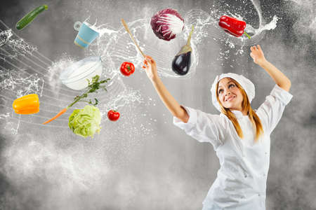 Foto per Girl cooking as a master of symphonic orchestra - Immagine Royalty Free