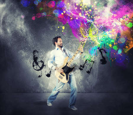 Photo for Boy play with bass guitar with colorful effect - Royalty Free Image