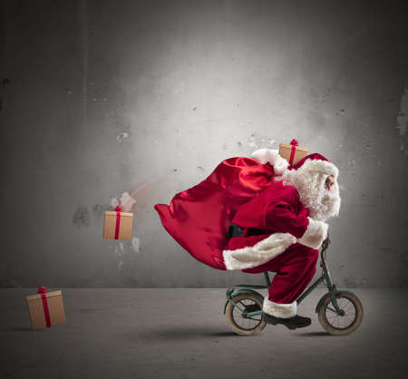 Photo for Fast Santa Claus on a small bike - Royalty Free Image