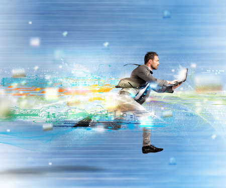 Photo pour Concept of fast internet with running businessman with a laptop - image libre de droit