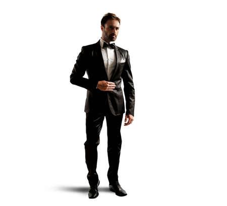 Photo pour A businessman wearing an elegant black tuxedo - image libre de droit