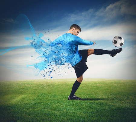 Photo pour Soccer player kicks ball in a field - image libre de droit