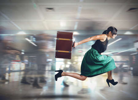 Photo for Woman runs late to the flight departure - Royalty Free Image