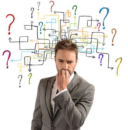 Photo pour Businessman thinks of solutions for his doubts - image libre de droit