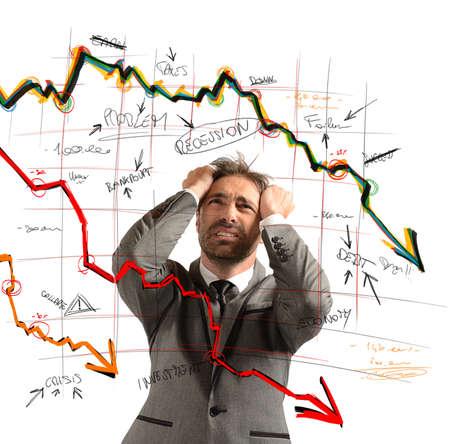Foto de Businessman stressed out by the financial collapse - Imagen libre de derechos