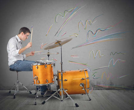 Photo for A drummer plays his instrument producing notes - Royalty Free Image