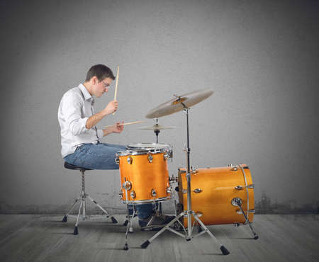 Photo for A musician plays his drums with passion - Royalty Free Image