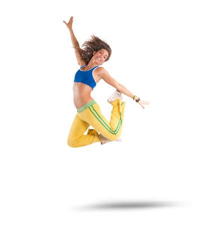 Foto de A dancer jumps in a zumba choreography - Imagen libre de derechos