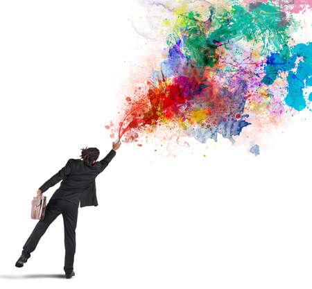 Photo pour Young and creative businessman colors with spray - image libre de droit