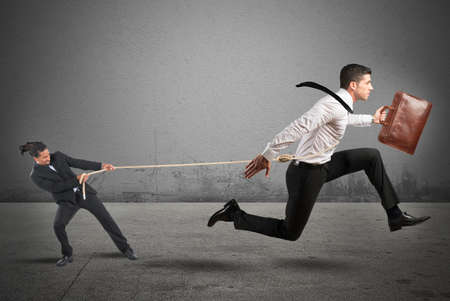 Foto de Boss tries to strongly retain his employees - Imagen libre de derechos