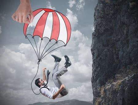 Photo pour Businessman is saved from a fall deep - image libre de droit