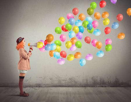 Foto de Clown funny and creative screams colorful balloons - Imagen libre de derechos