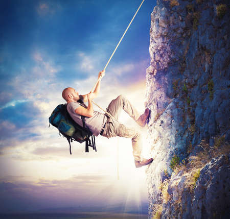 Photo for Explorer and his passion for climbing mountains - Royalty Free Image