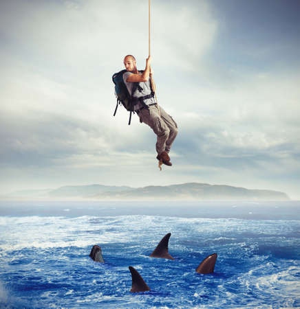 Foto de Explorer frightened by hungry sharks under him - Imagen libre de derechos