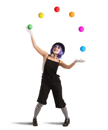 Photo pour Clown playing with balls like a juggler - image libre de droit