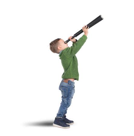 Photo for Child plays explore and discover with binoculars - Royalty Free Image