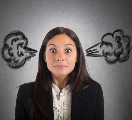 Foto de Businesswoman stressed with the brain in smoke - Imagen libre de derechos