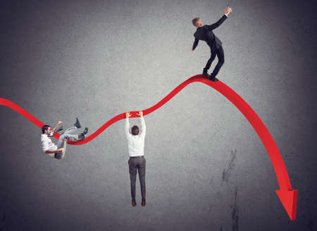 Foto de Businessmen falling down toward the economic crisis - Imagen libre de derechos