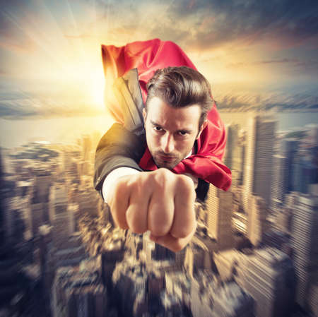 Photo pour Businessman superhero flies faster in the sky - image libre de droit
