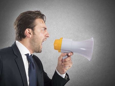 Photo pour Angry business boss shouting with his megaphone - image libre de droit