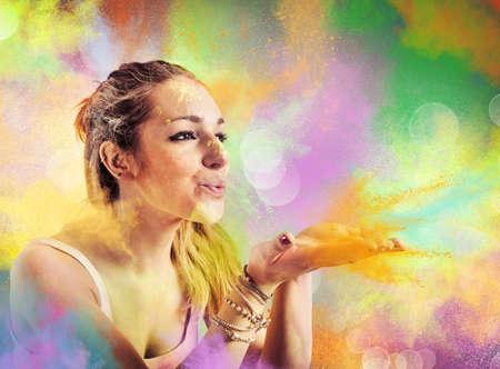 Foto de Girl blowing dust colored like a rainbow - Imagen libre de derechos