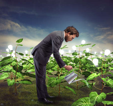 Foto de Businessman take cares and nurtures new ideas - Imagen libre de derechos