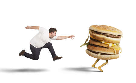 Photo for Insatiable fat man runs for catch sandwich - Royalty Free Image