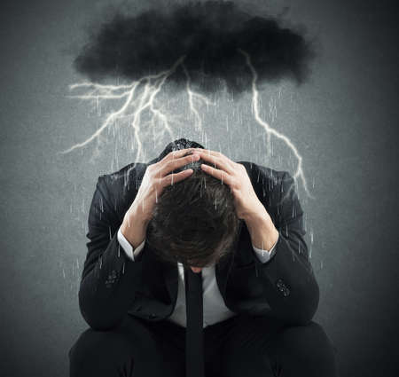 Photo for Desperate businessman with cloud over his head - Royalty Free Image