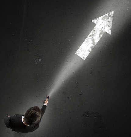 Photo pour Man lights the right direction to take - image libre de droit