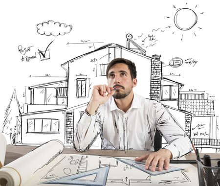Photo pour Architect thinks how to design a house - image libre de droit