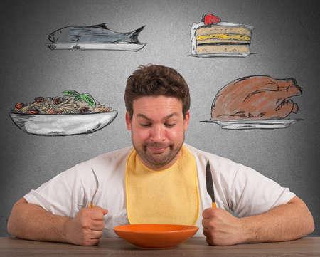 Foto de Hungry man thinks about what to eat - Imagen libre de derechos