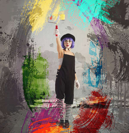 Photo for Creative artist clown paint with the roller - Royalty Free Image