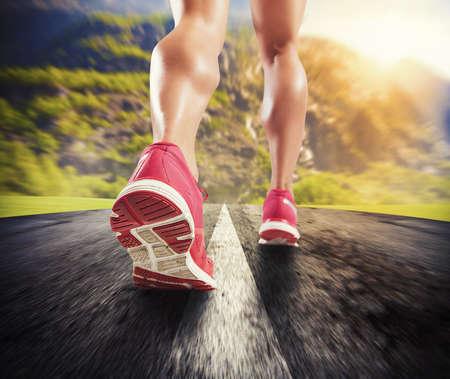 Photo pour Legs of sporty woman running on asphalt - image libre de droit