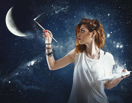 Photo for Girl paints the moon and the stars - Royalty Free Image