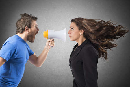 Foto de Man shouting with megaphone to a businesswoman - Imagen libre de derechos