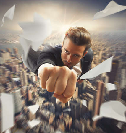 Foto per Businessman flying over the city like superhero - Immagine Royalty Free