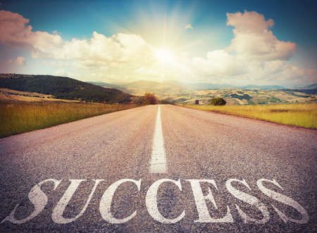 Photo pour Road that says success in the asphalt - image libre de droit
