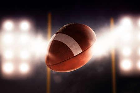 Football ball flying fast through the air