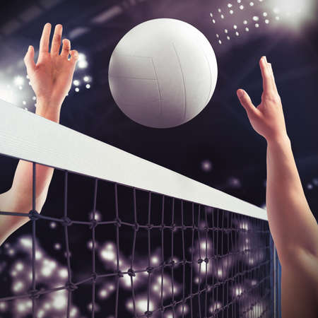 Photo pour Volleyball ball over the net during match - image libre de droit