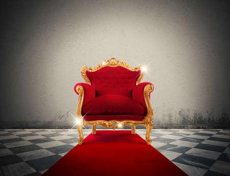 Photo pour Sparkling golden armchair in a red carpet - image libre de droit