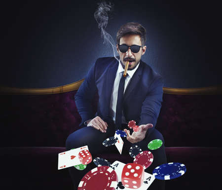 Foto de Rich gambler throws cards dice and chips - Imagen libre de derechos